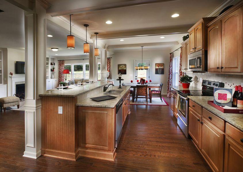 Kitchens With Columns traditional kitchen with hardwood floors, giallo verona granite