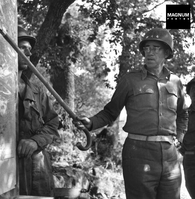 General Omar BRADLEY talking to his officers at a field command post,Troina, July 1943//Robert Capa