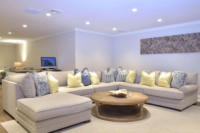 Large Sectional Couch With Round Coffee Table In Basement Livingroomideas Livingroom Layout Large Sectional Couch Living Room Furniture Layout