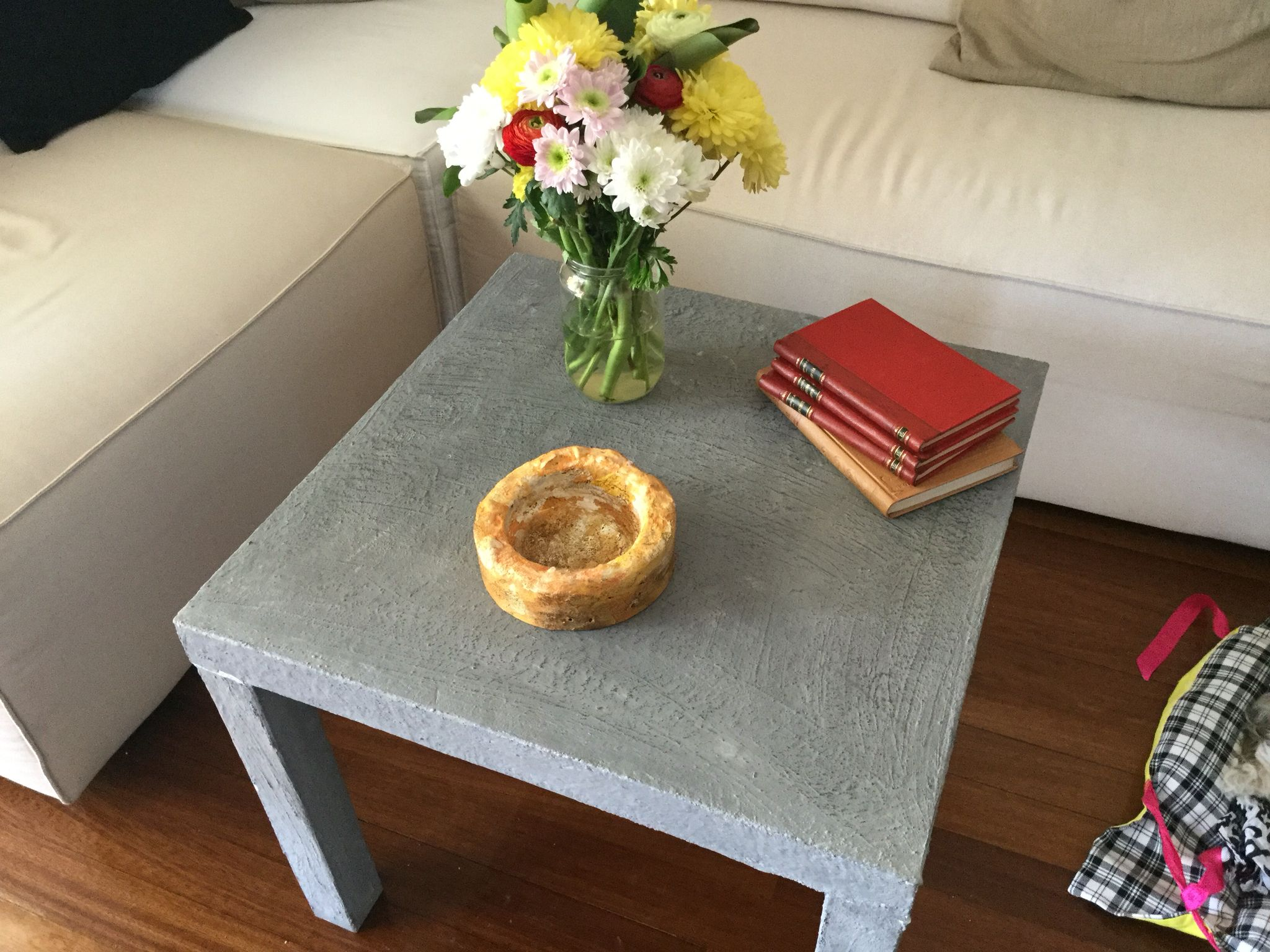 Ikea lack table with a thin layer of concrete for a complete