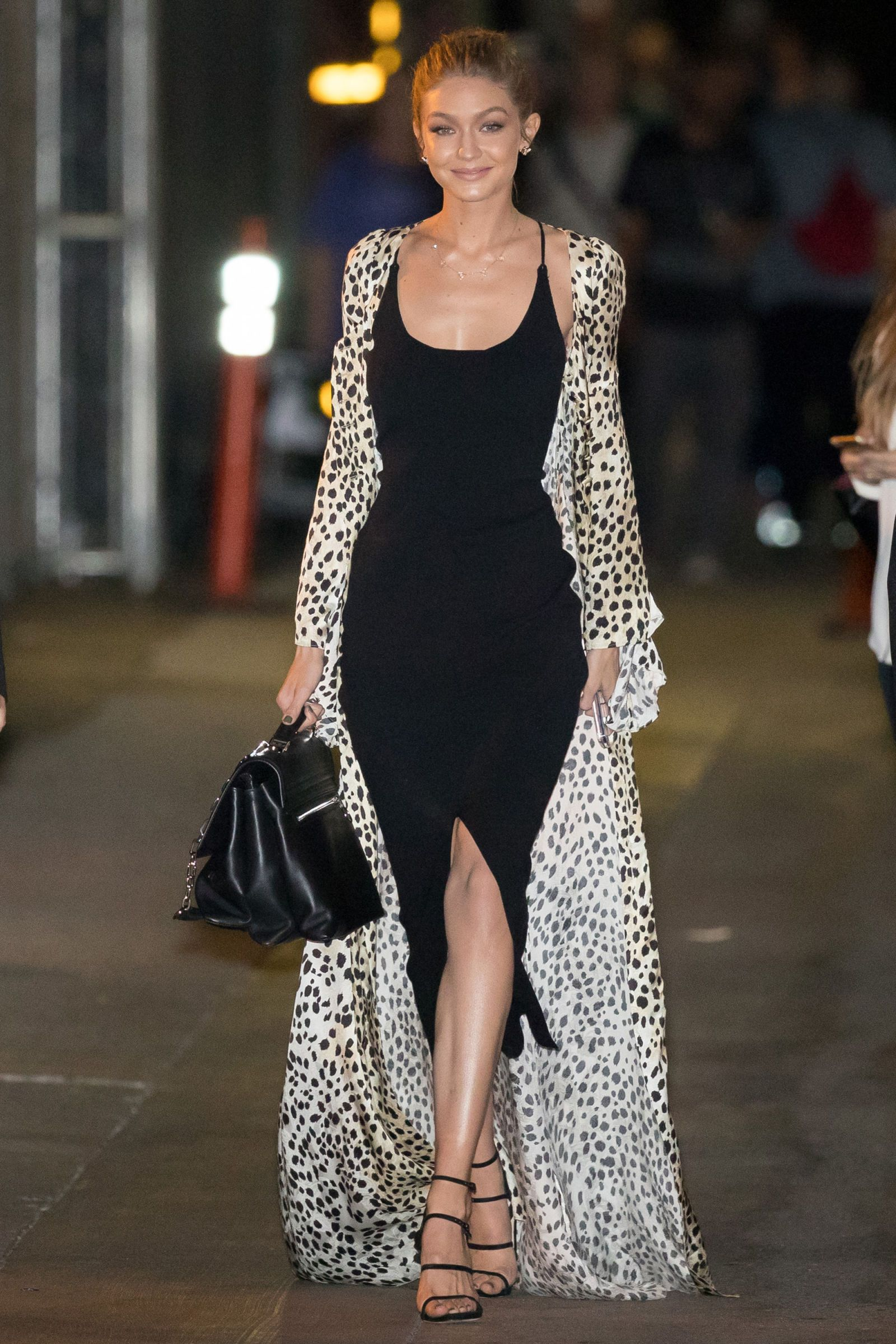 c6c315bbfd61 Gigi Hadid looked feminine in a black bodycon dress and black and white  silk dress robe