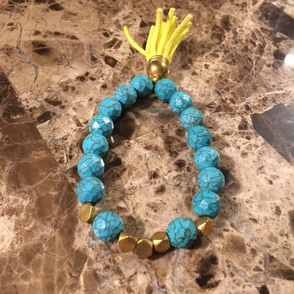 Turquoise beaded bracelet Super cute turquoise beaded bracelet with neon yellow tassel. Jewelry Bracelets