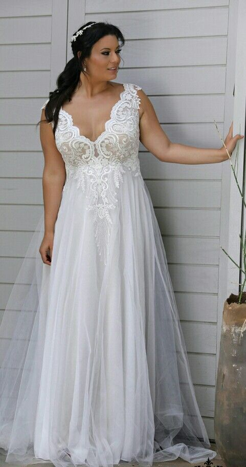 unique plus size wedding gown with a gentle flowy skirt and lace v