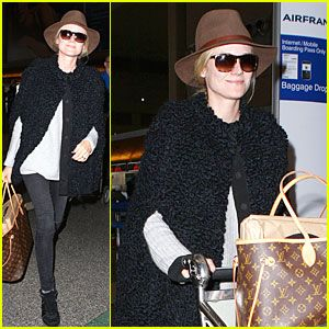e1bda8832299d Diane Kruger carries her chic Louis Vuitton bag while arriving for a  departing flight at LAX Airport on Wednesday (December 4) in Los Angeles.