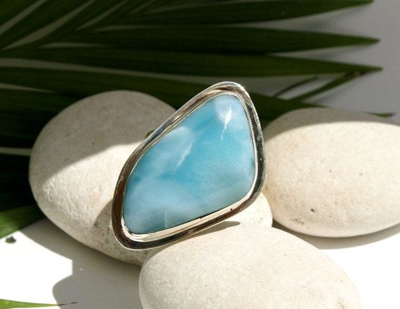 Gorgeous Huge Larimar free form .925 sterling silver ring. Size 7.75  Measurements: 36 x 22 x 8mm - 1 7/16 x 7/8 Weight: 13.7g - 0.48oz - 68.5ct    LARIMAR Larimar, also known as dolphin stones are special for several reasons, first they are a rare form of naturally occurring pectolite that has only been discovered in the Dominican Republic, they are millions of years old and once polished they reveal several intense shades of blue. They are prized by artists for their beauty and durability…