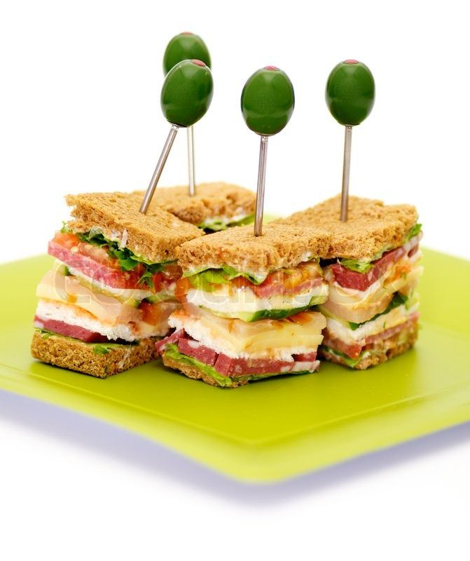 Stock image of 'Snacks of Classical BLT Club Sandwich isolated on green plate'