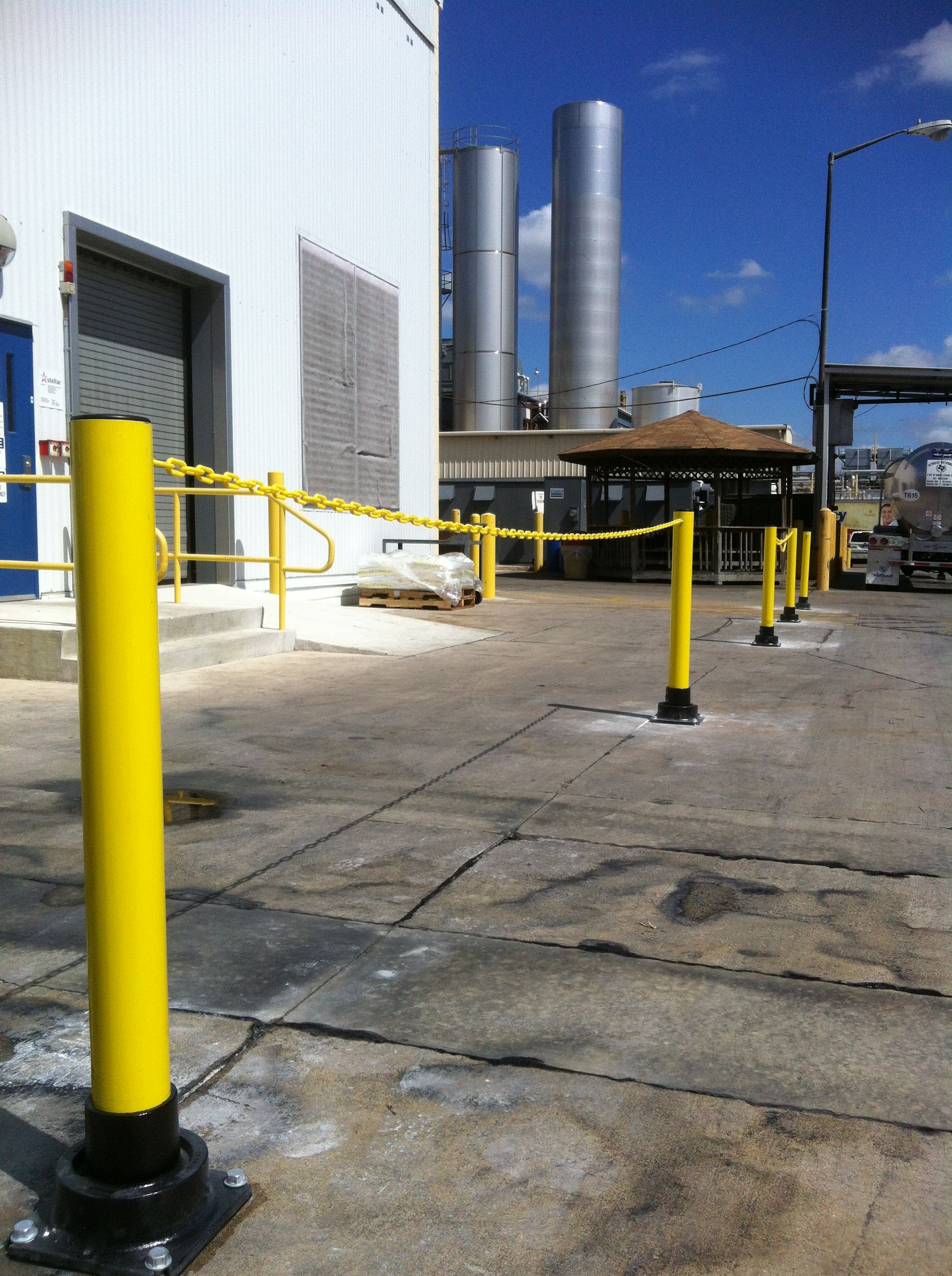 heb warehouse in san antonio tx became a recent fan of slowstop bollards this installation shows chains connecting the bollards together to create a  [ 1936 x 2592 Pixel ]