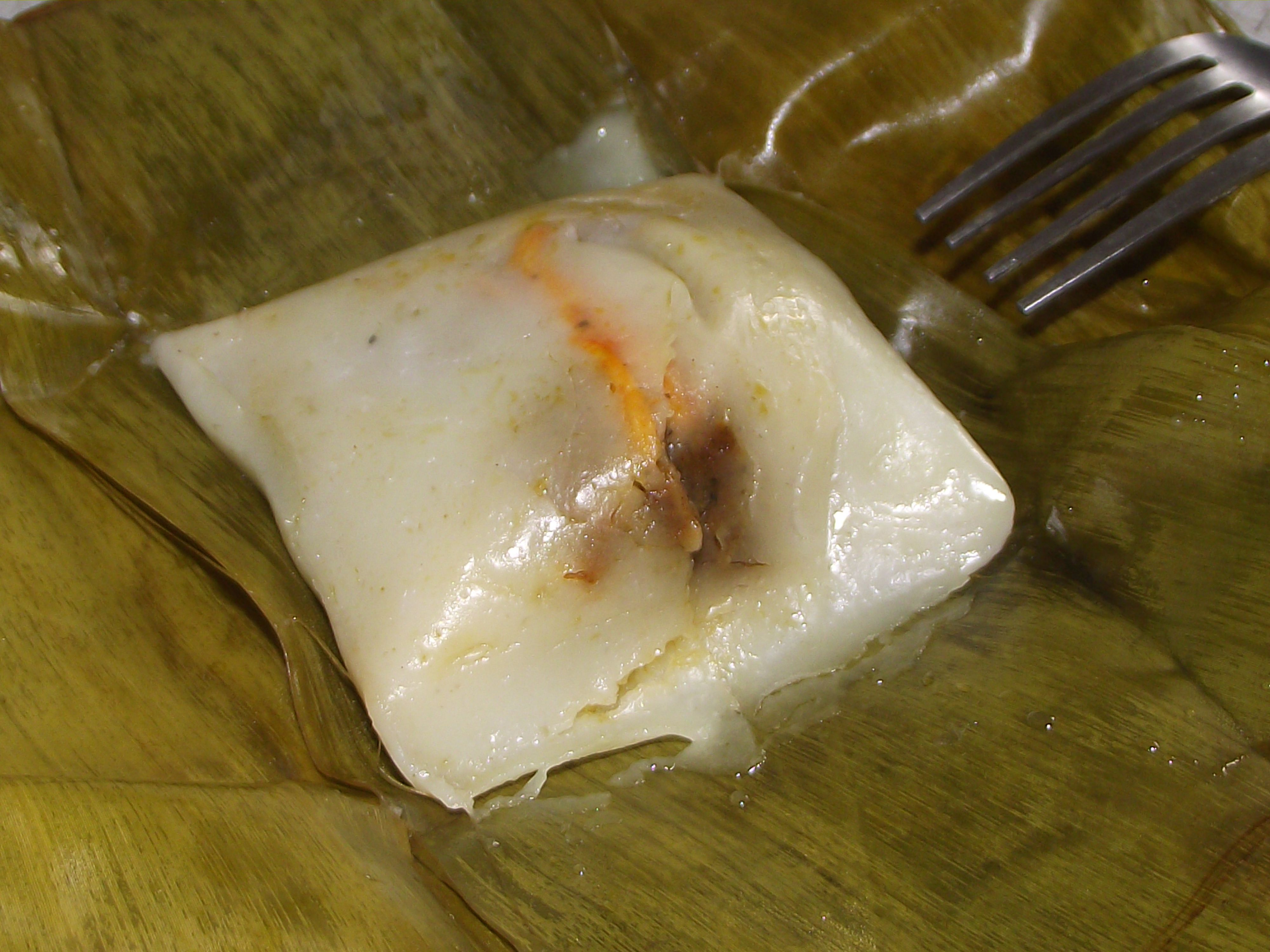 Filipino Tamales Made From Rice Paste And Filled With A Savory Mix Of Chicken Ground Peanut And Colored With Anatto Seeds It S Then Wrapped In Banana