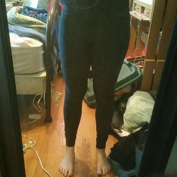 Dri- fit Nike leggings Dark grey almost black. Only wore them a couple times i never really liked them. Bought them from nike. They are the Dri-Fit kind. Nike Pants Leggings