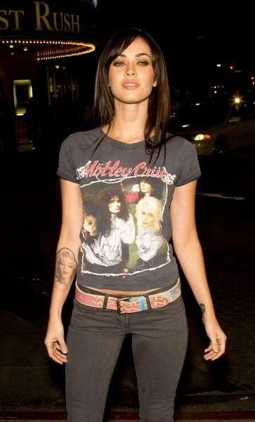 Megan Fox in a black, vintage, Motley Crue tee shirt with black jeans and leather belt.