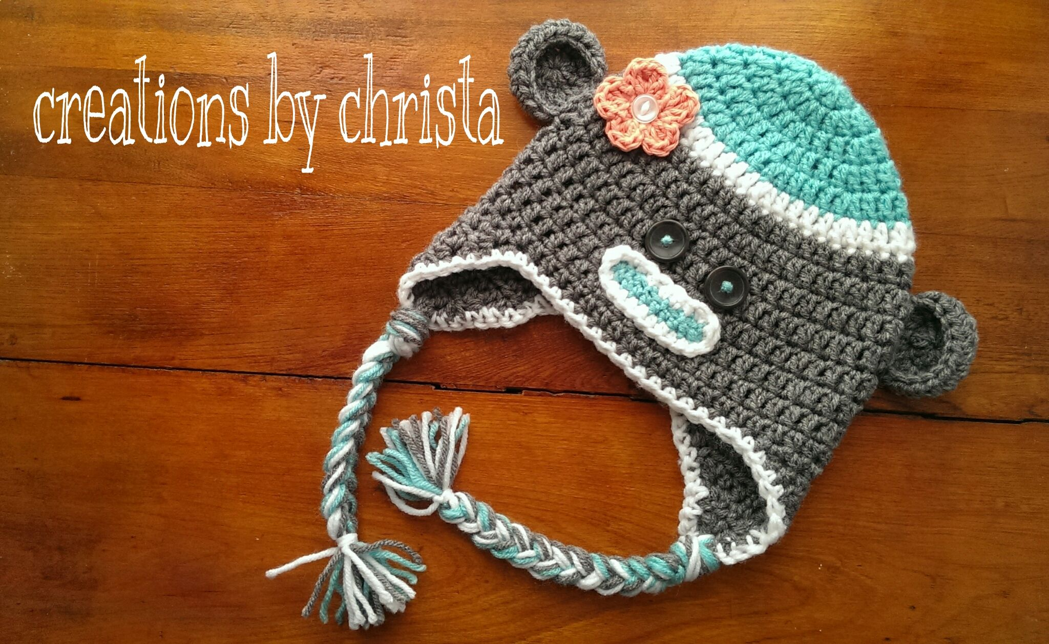 Sock Monkey crochet hat.  Main hat free pattern used courtesy of Repeat Crafter Me Owl hat pattern: http://www.repeatcrafterme.com/2012/09/crochet-owl-hat-pattern-in-newborn.html Monkey details courtesy of Daisy Cottage Designs free pattern: http://www.daisycottagedesigns.net/2013/04/free-sock-monkey-crochet-pattern.html