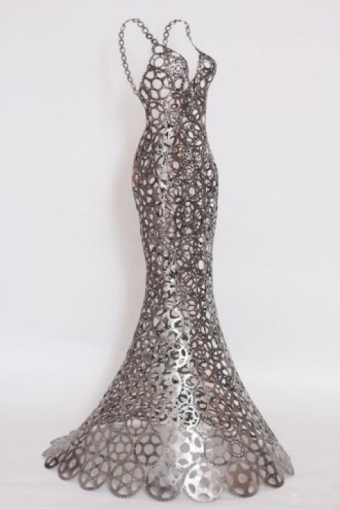 """In addition to her lifelike dog sculptures, Nirit Levav Packer creates """"dresses"""" out of bicycle parts."""