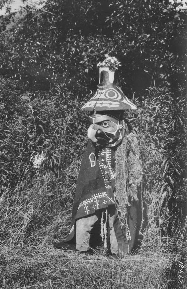 Nuxalk masked dancer near Komkotes Village in Bella Coola Valley, British Columbia - 1927