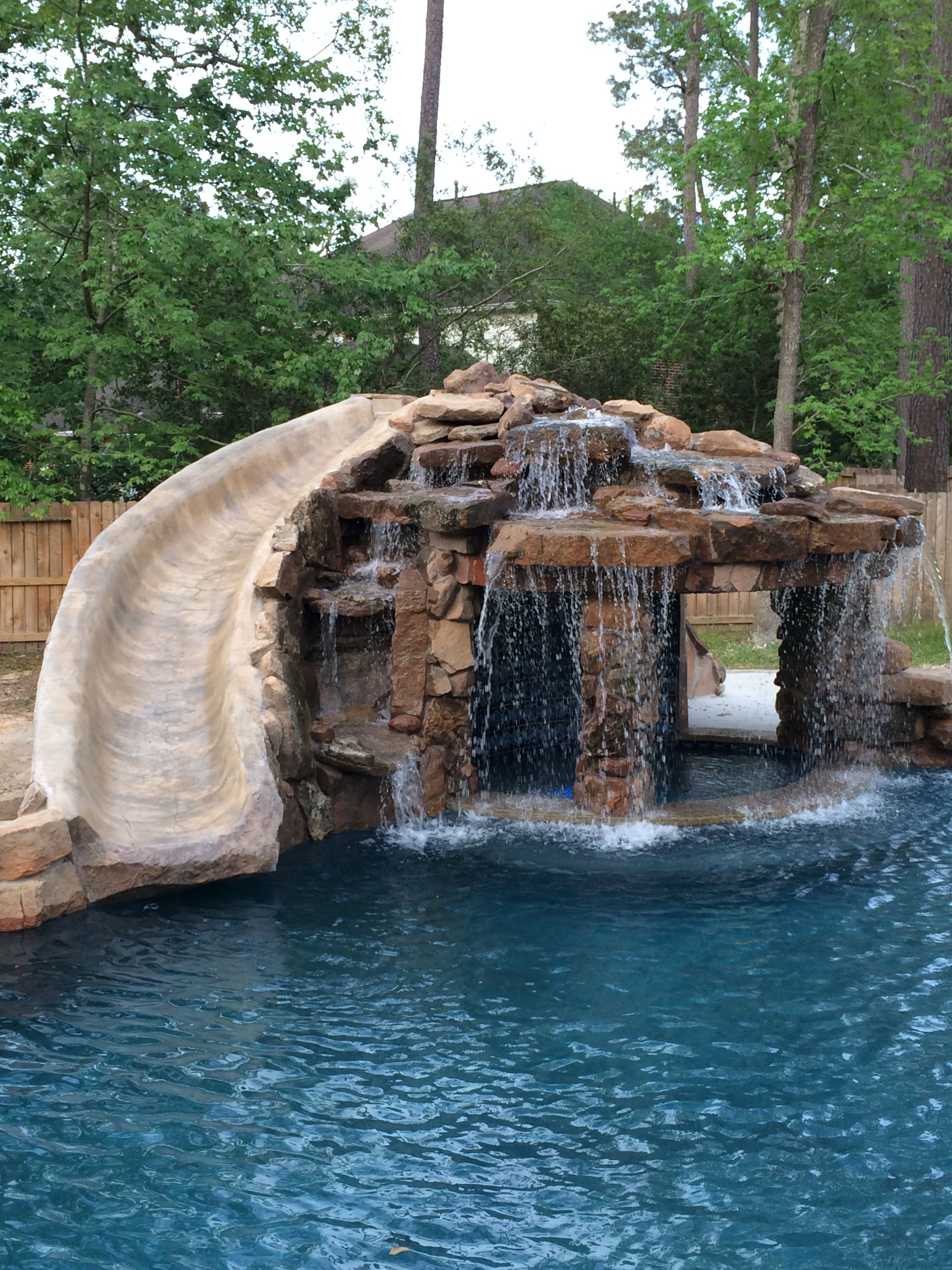 Inground swimming pool slide grotto pools by mitchell for Pool design with slide