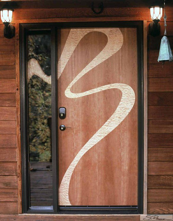 Inlaid wood doors with sinuous designs, part of Reuman's…