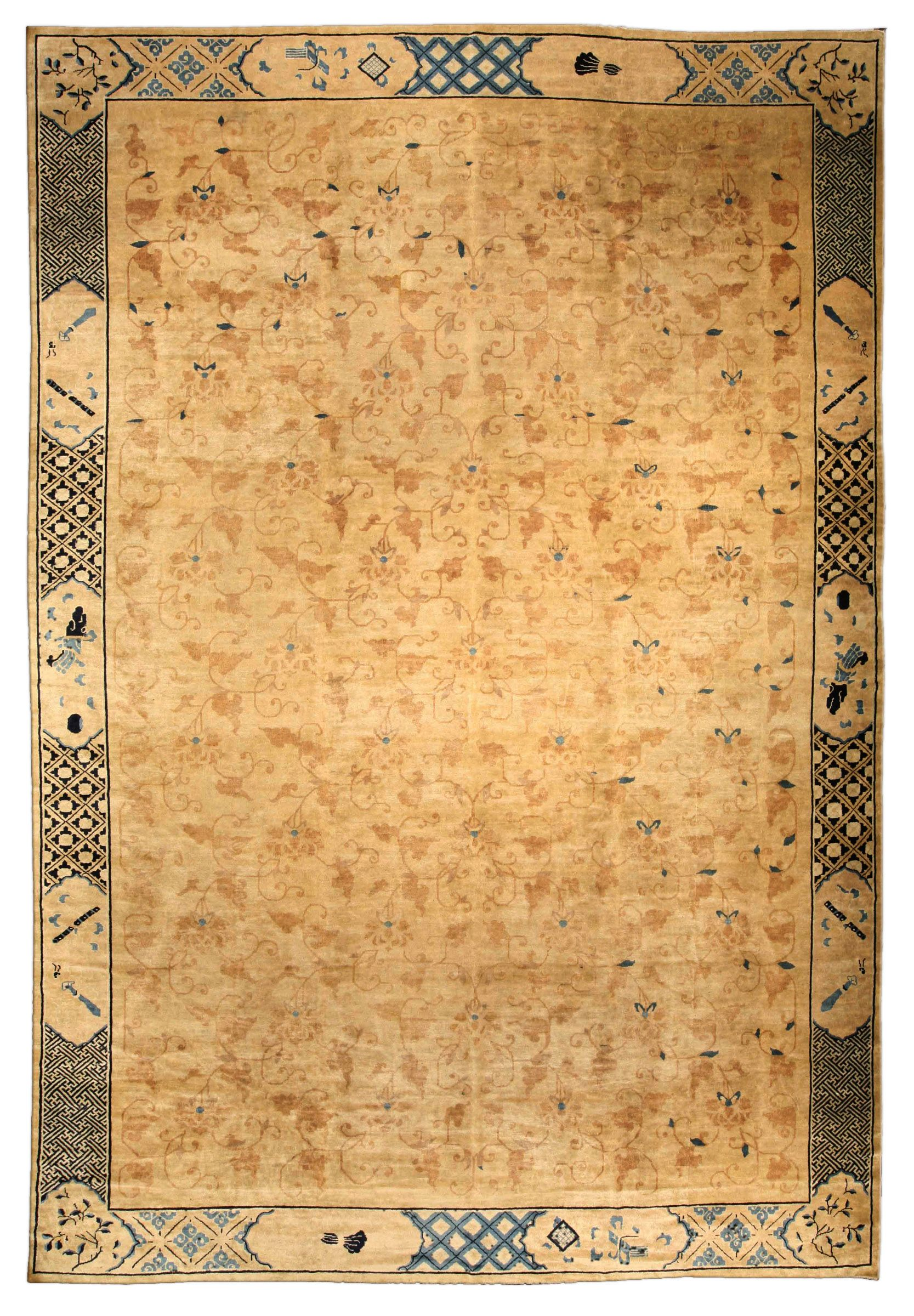 A Chinese carpet BB4088 - An early 20th century Chinese antique rug, the sand field with a subtle overall pattern of scrolling delicate viner ...