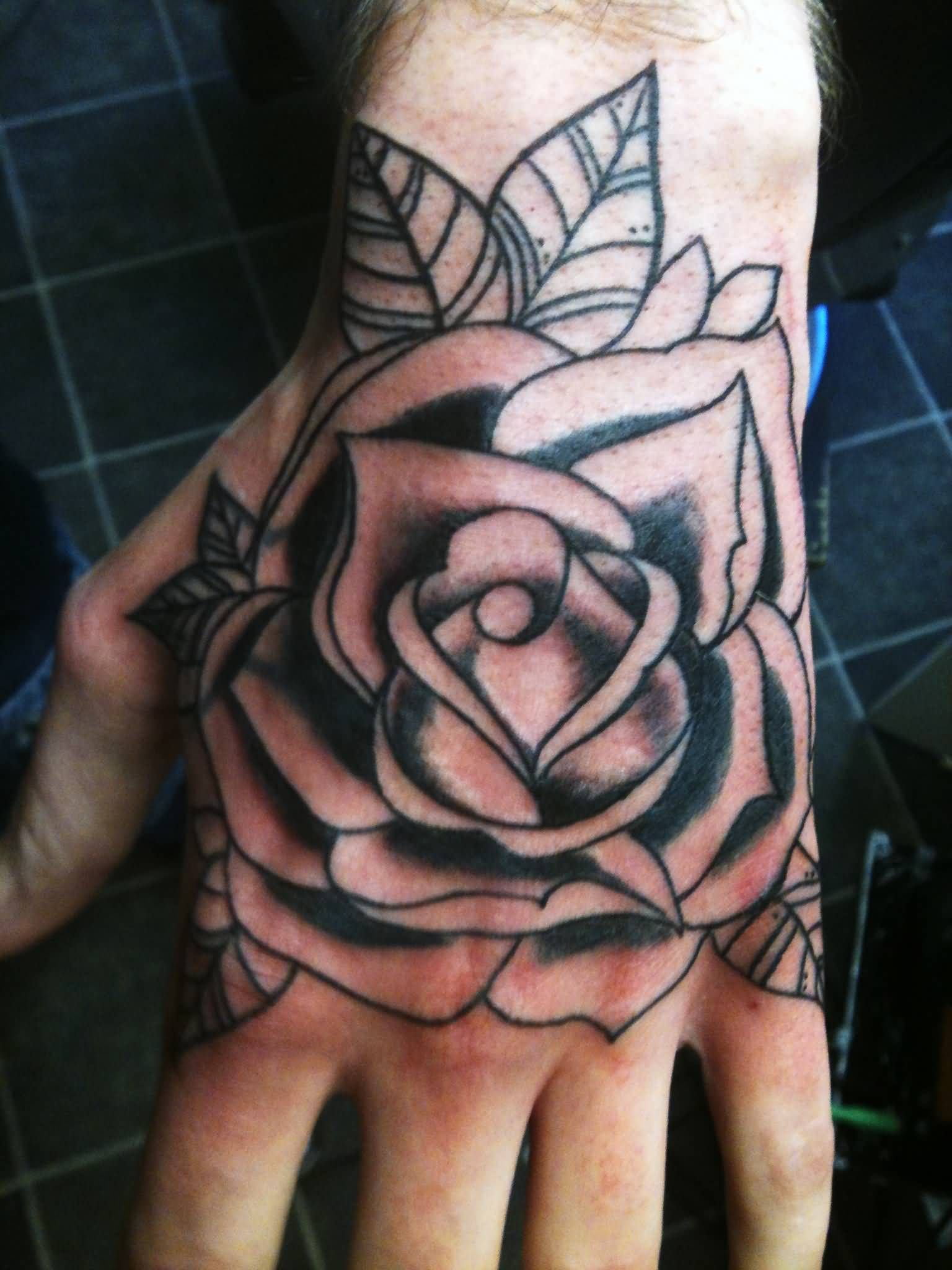 Grey And Black Rose Tattoo On Left Hand Rose Hand Tattoo Hand Tattoos For Guys Rose Tattoos For Men