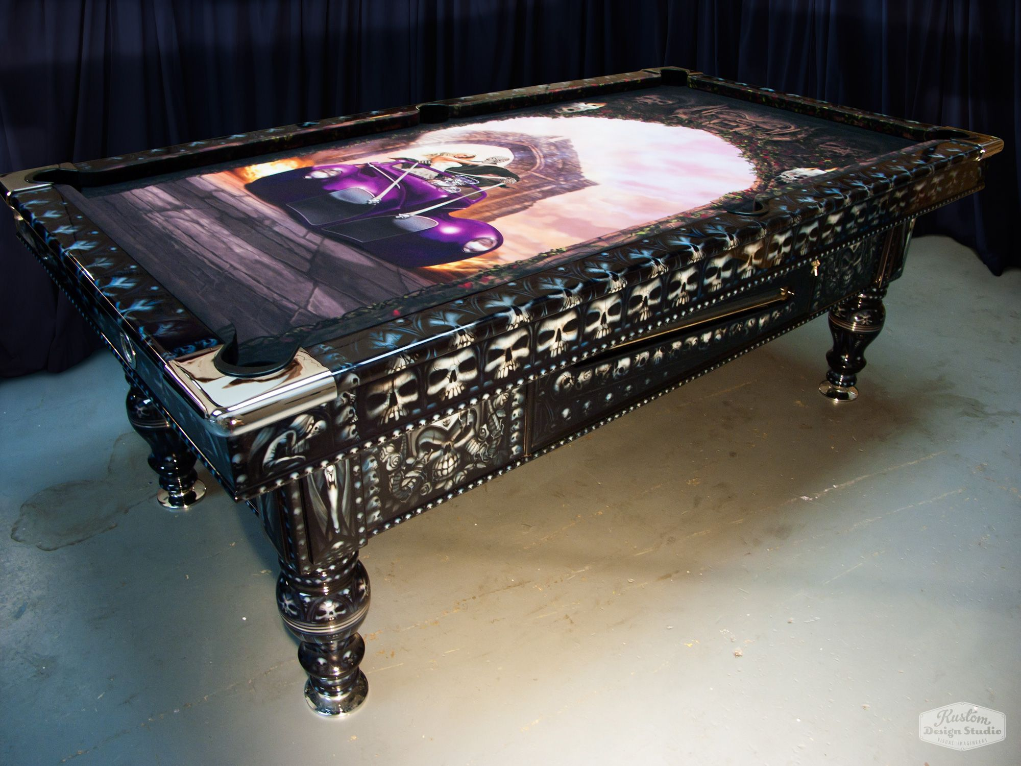 Airbrushed pool table with almost 4000 skulls by Brent Larsen