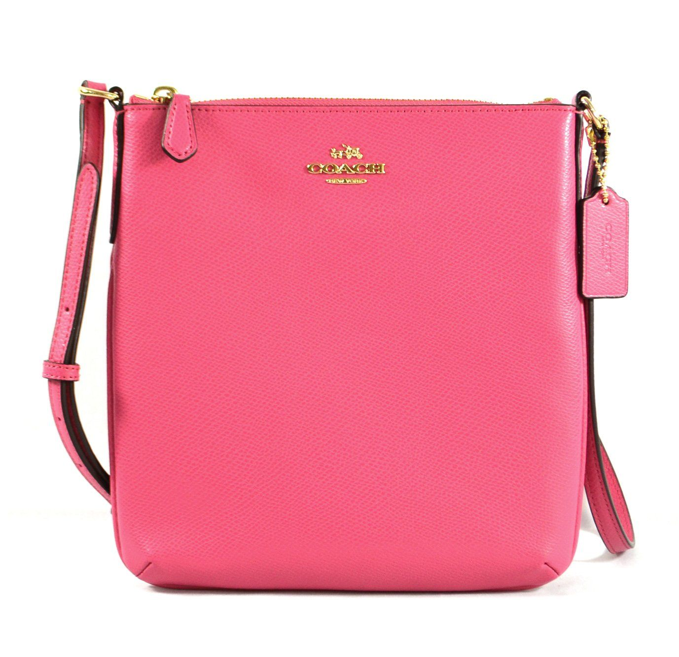 """Coach Crossgrain Leather North South Crossbody Dahia Pink. Made of cross grain leather. Strap for shoulder or cross body wear. Zip top closure, fabric lining. Inside 1 slip pocket, outside 1 back slip pocket. 8.25"""" (L) x 8.75"""" (H) x 1""""(D)."""