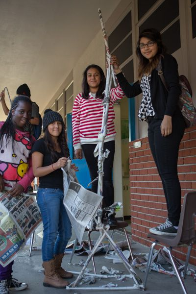 """All-girl team of 8th graders won the Tallest Tower Contest at Bud Carson STEM Academy this week--they had only newspaper and """"a limited amount of tape"""" to get it done.  Congratulations to Vanessa, Viviana, Sara, and Helena!  (Photo from Trash for Teaching, which facilitated the activity.)"""