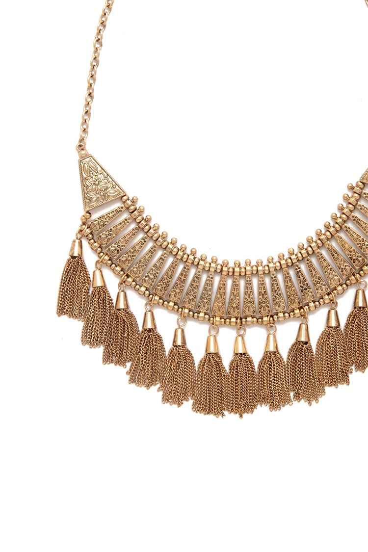 A midweight statement necklace featuring an etched floral design with hanging high-shine chain tassels and a lobster clasp.