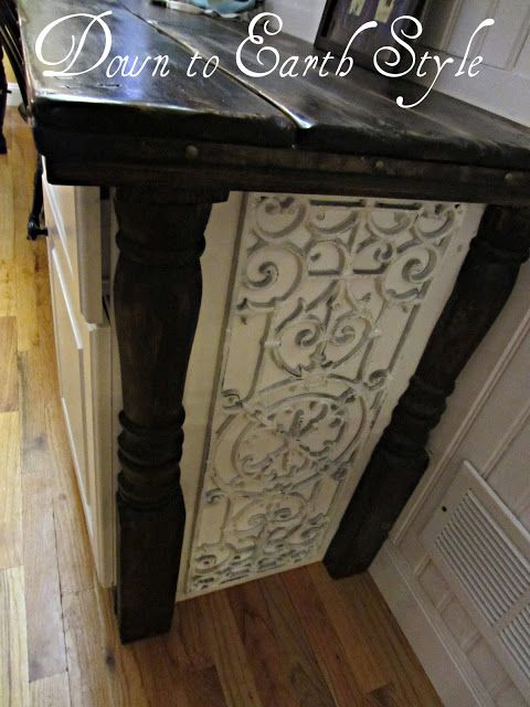 Charming Details for Home:  Use a rubber mat with a scroll design to add detail to the side of a cabinet.