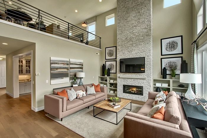 Love The Two Story Open Great Room With The Full Height Stone Fireplace A Modern Look With Functionality The Enclave At Home Family Room Home Remodeling Diy