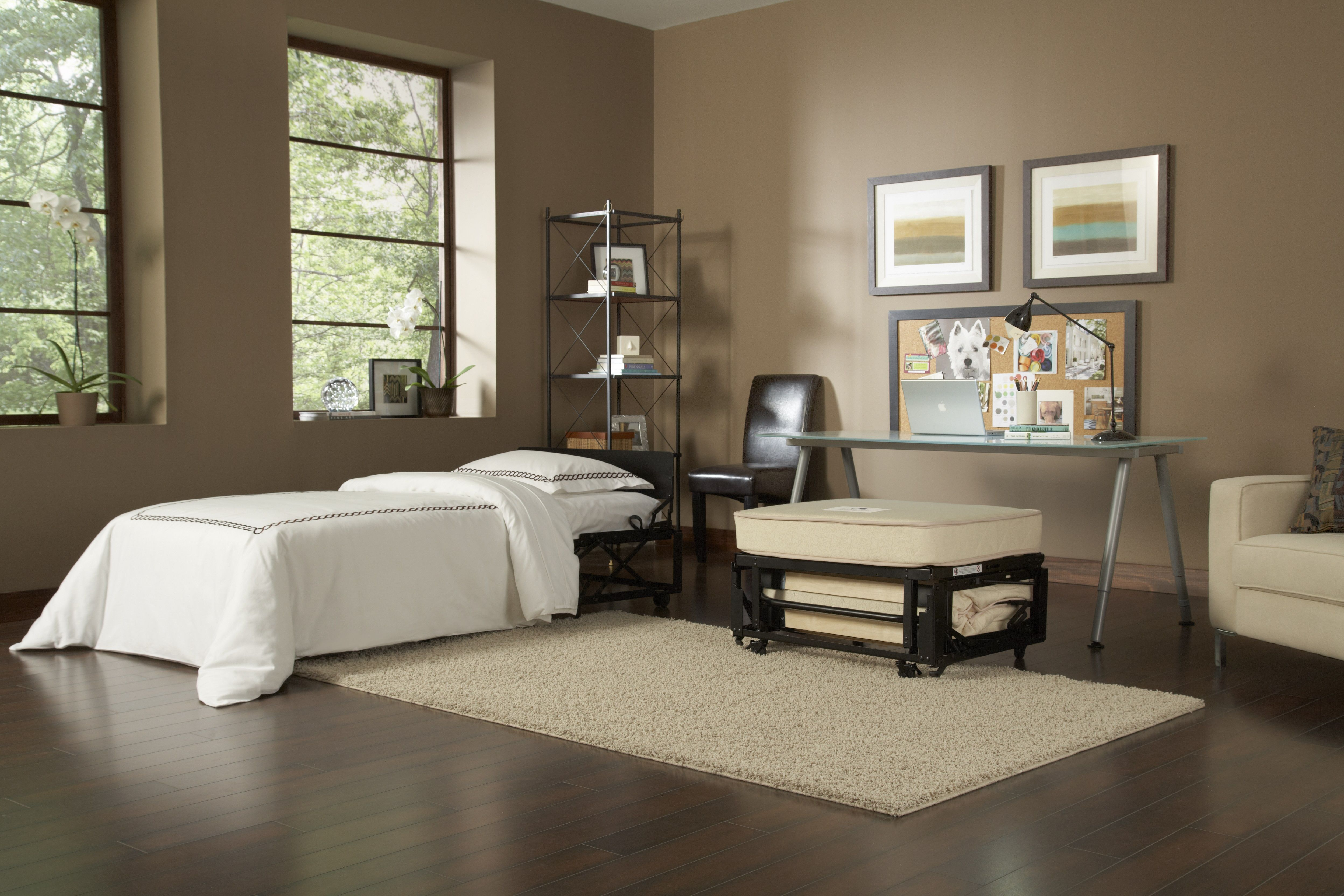 By Eliminating The Standard Bed And By Adding Two Castro Convertible  Ottomans, One Can Transform