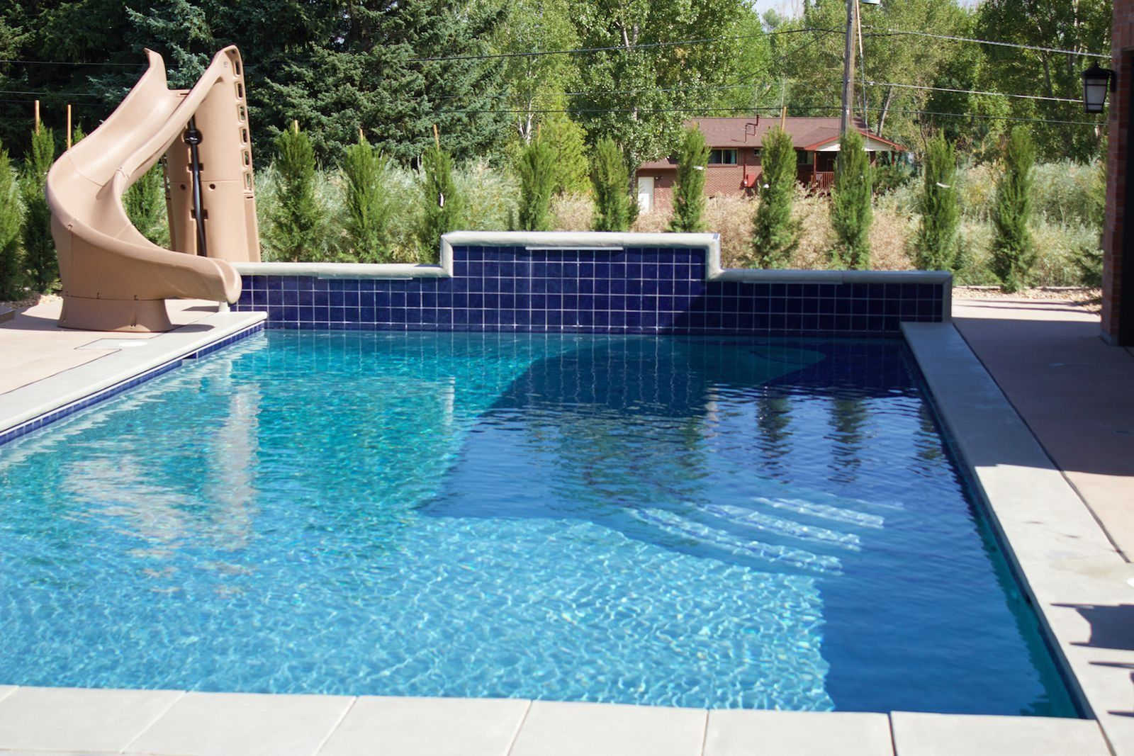 Outdoor pool with slide  Choosing The Right Outdoor Pool Slide   Pinterest   Pool slides and ...
