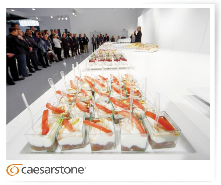 Full booth with great food served at Eurocucina, on a white Caesarstone countertop