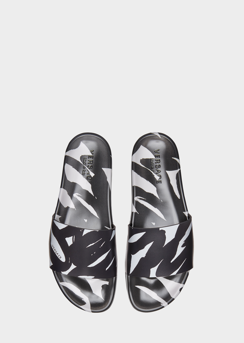 dece5ff03ea  295 VERSACE Graffiti Print Rubber Slides from Versace Men s Collection.  Flat rubber pool slides in Graffiti print inspired by street markings in  Berlin ...