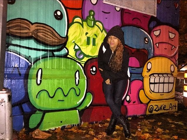 nighttime pose by Miss Zukie with her work - Brooklyn, New York - 11/14 (LP)