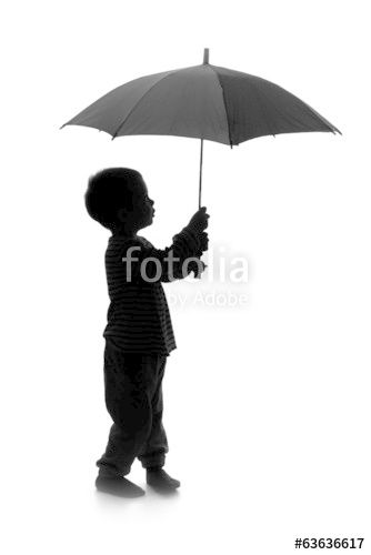 silhouette of little boy with umbrella profile background and