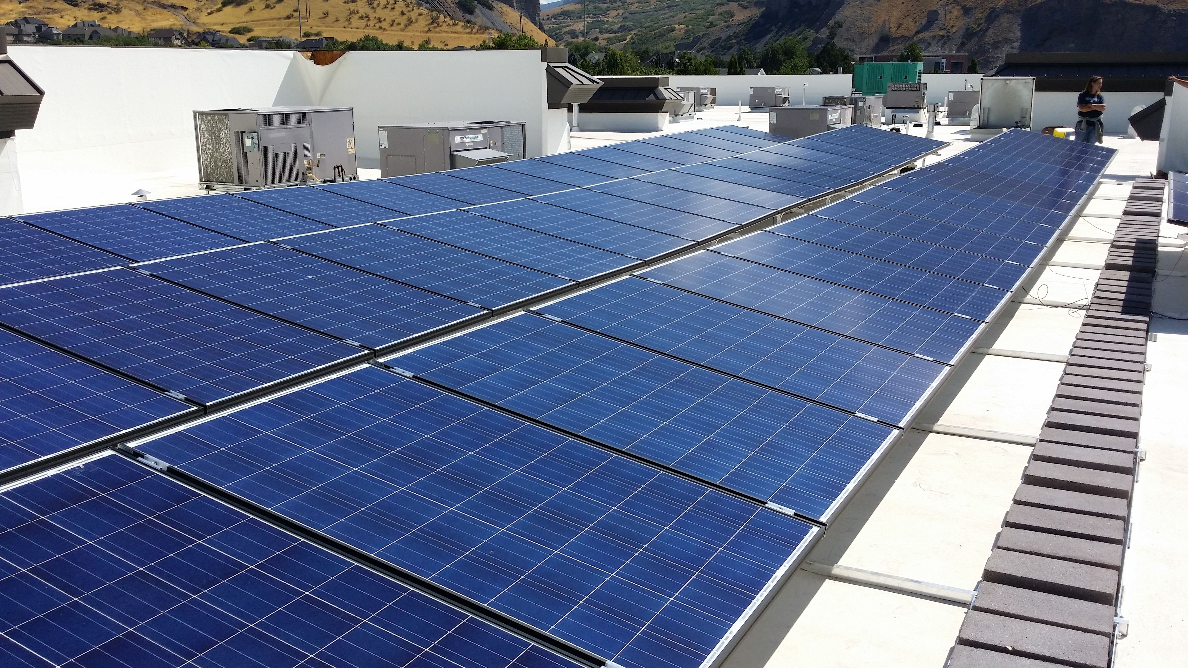 Tra Snow And Sun S Solar Ballast System Installed On A Flat Roof In Orem Ut Landscaping Retaining Walls Roof Solar Panel Solar Panels