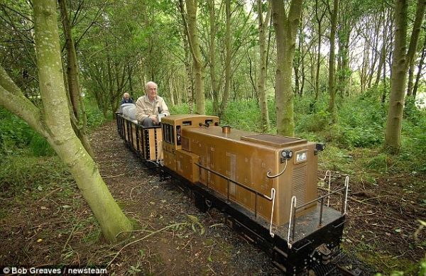 Railway track complete with private train build by 80 year ...