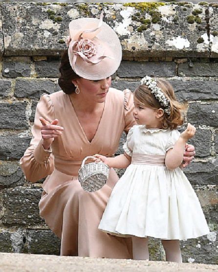 Catherine, Duchess of Cambridge and Princess Charlotte of Cambridge, bridesmaid leave the wedding of Pippa Middleton and James Matthews at St Mark's Church on May 20, 2017 in Englefield Green, England.