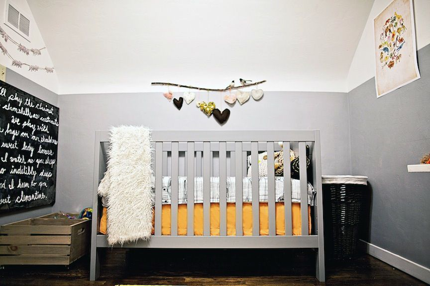 Love the stick/hearts above the crib, the orange accents and the chalk board section