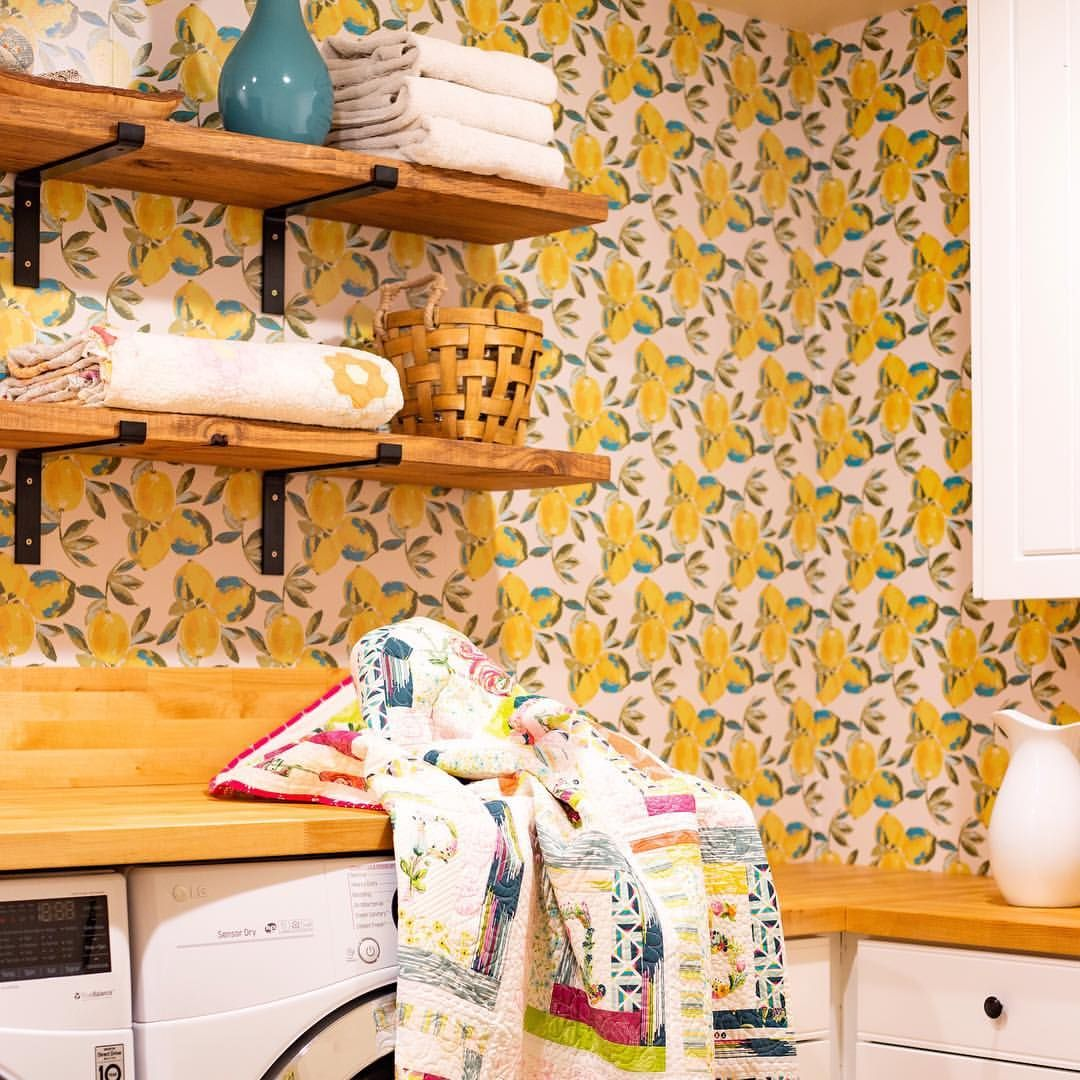 Laundry room in Bari J. Home. Lemon print wallpaper by