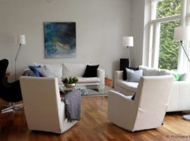 livingroom with white armchairs