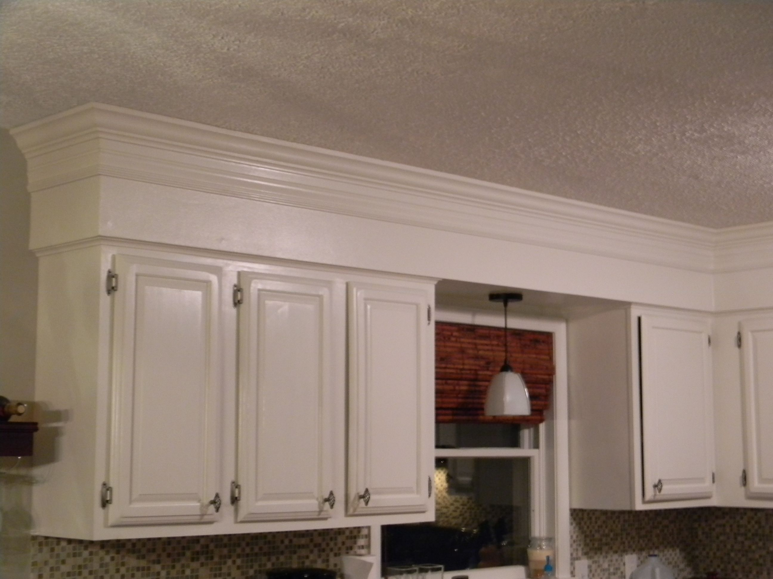 Merveilleux Make Your Old Cabinets Look Like Custom To The Ceiling Cabinetry By Adding  Some Crown Molding And Painting The Bulkhead And Old Cabinets To Match.