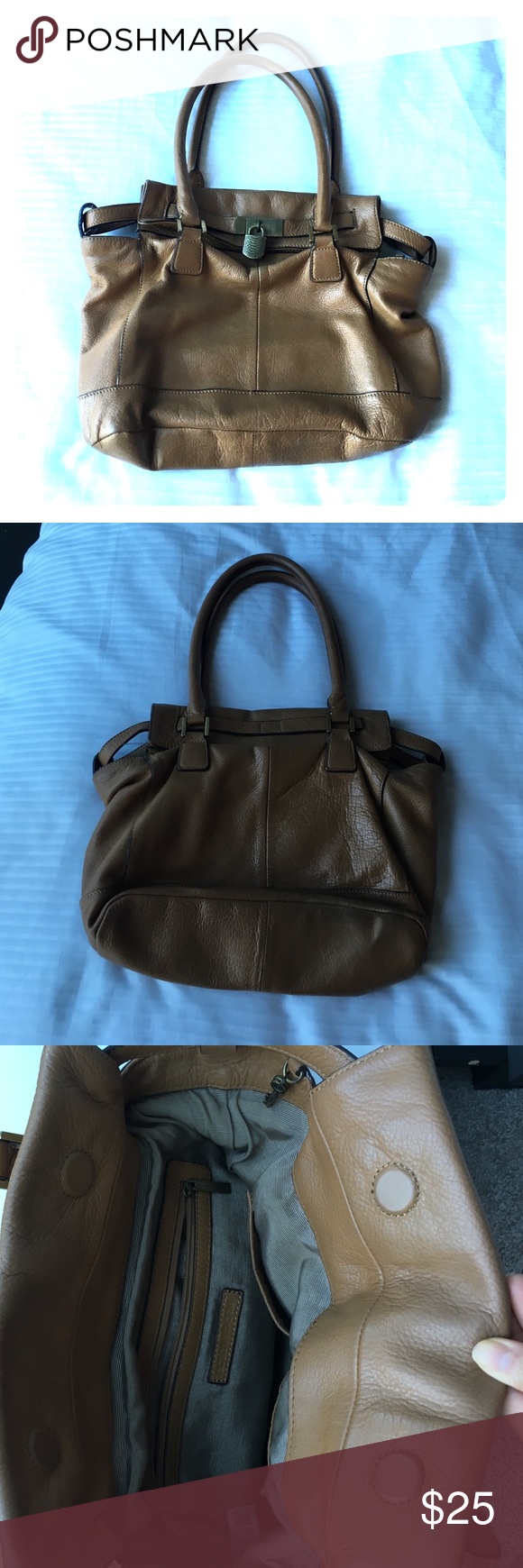 Tan, medium sized BCBG Maxazria handbag Used BCBG tan purse. Matches with tons of outfits. Magnets close the bag. Zipper inside. Real leather. Leather a bit worn on the back of the purse (not visible when worn). BCBGMaxAzria Bags Shoulder Bags