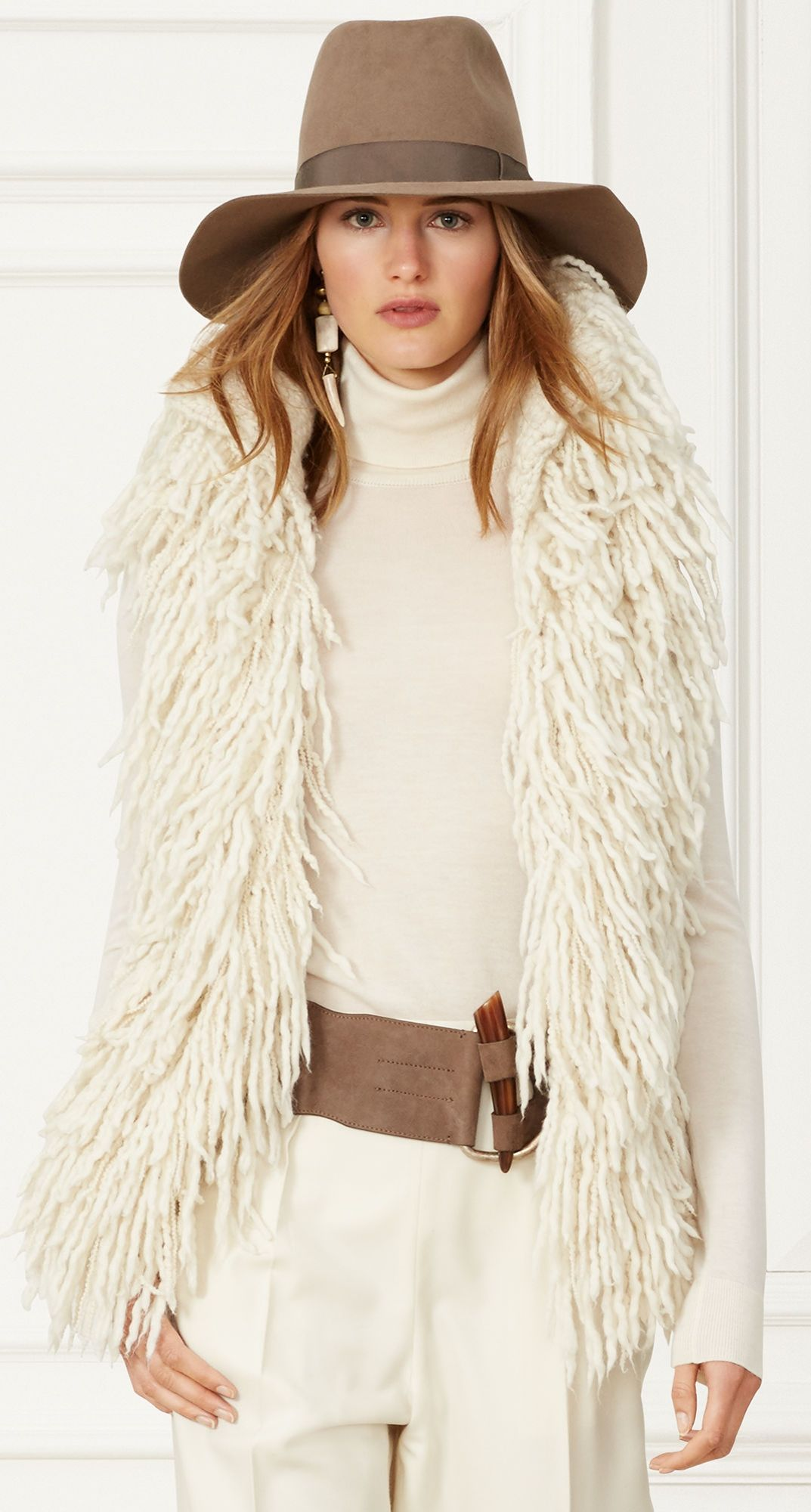79bdc2e7cefca Ralph Lauren Fall 2015 Collection  This cream hand-knit vest has a  voluminous silhouette that makes it perfect for layering. Pair the luxe wool -and-cashmere ...