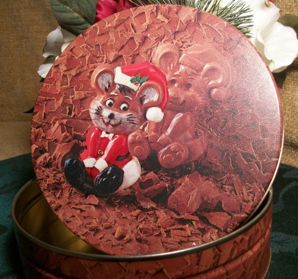 Christmas candy box mouse in santa suit sitting in