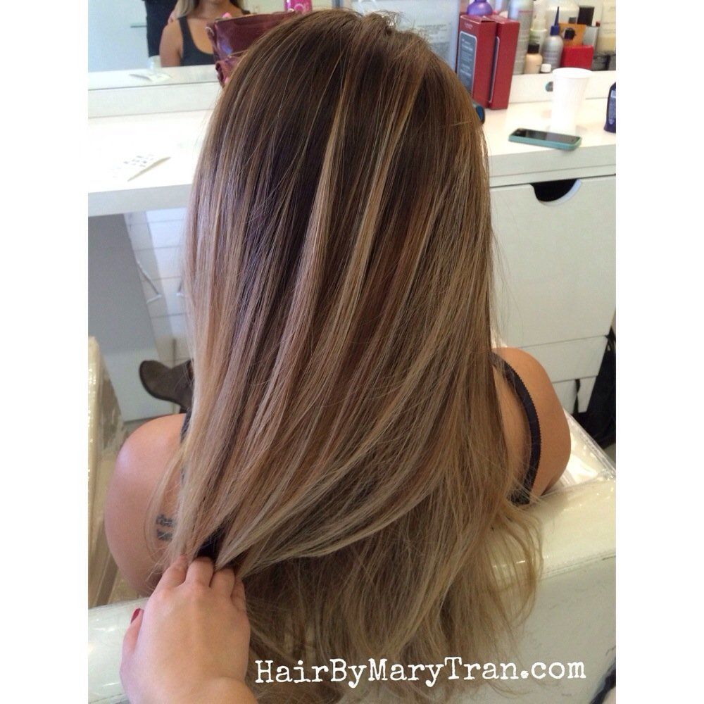 Mary Tran , Santa Monica, CA, United States. Blended ombre balayage highlights with light brown base color. More