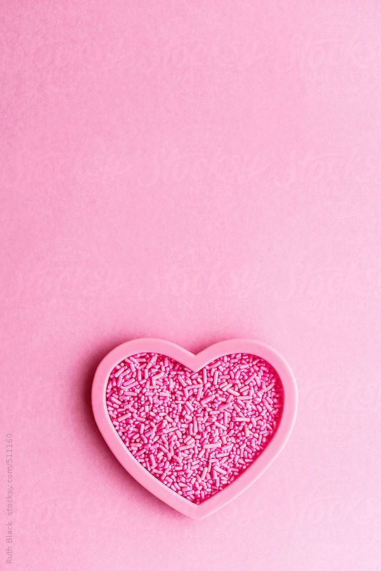 Heart shaped cookie cutter filled with sprinkles by