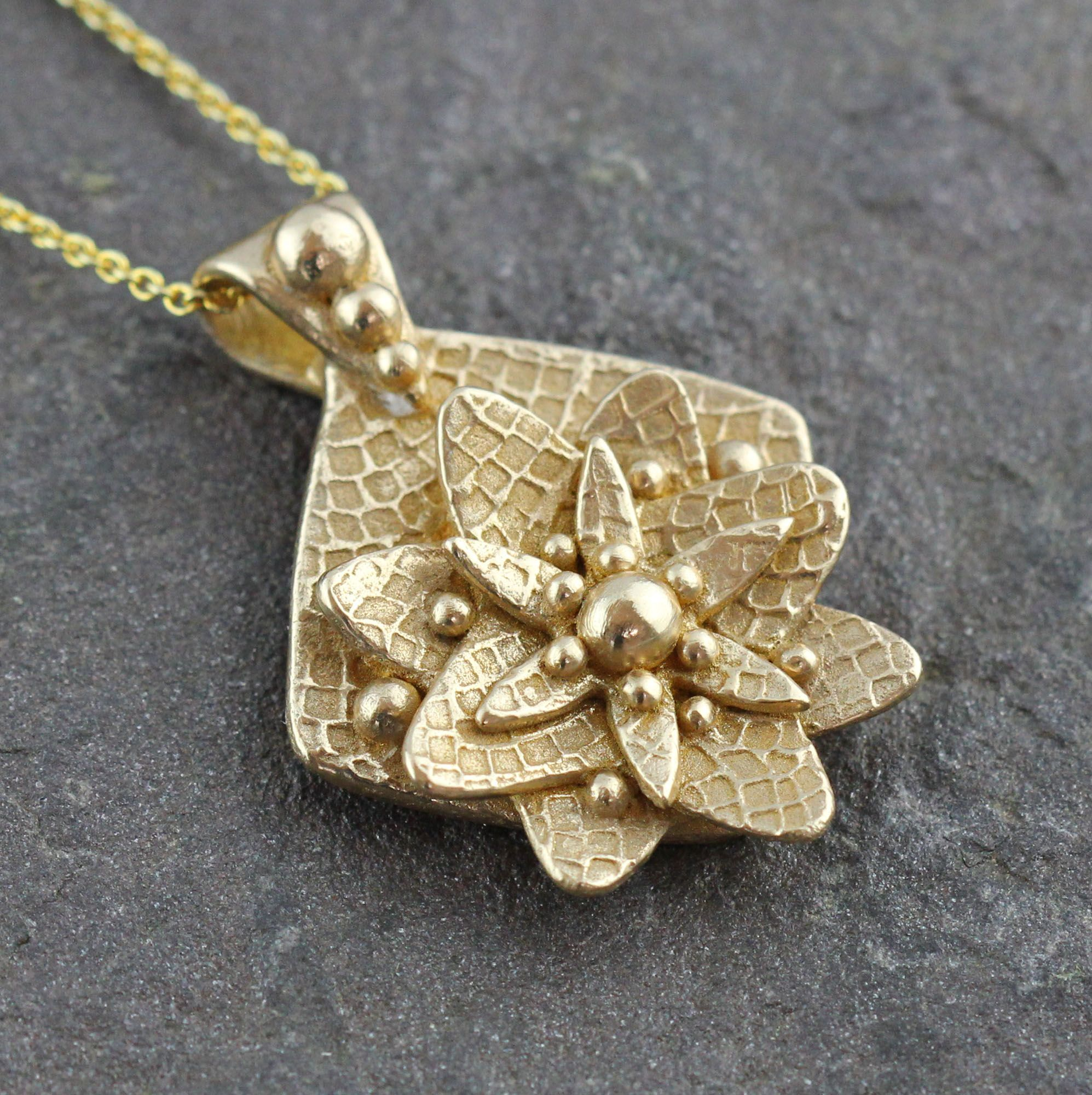 Golden flower necklace Sculpted and textured this gold bronze