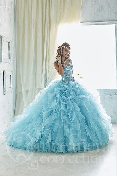 A style made to impress, complete with stunning ruffle tulle peppered with appliqués and a gorgeously beaded bodice with beaded straps. Download the Quinceanera Collection by House of Wu sizing chart