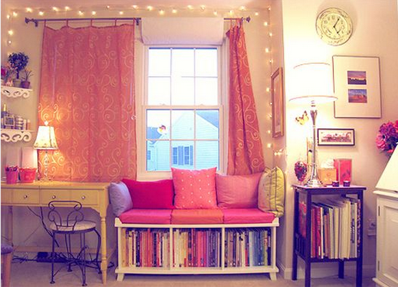 Christmas lights, sideways bookshelf with cushions to make couch ...