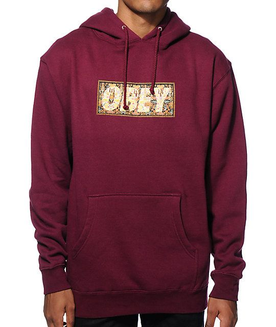 15d88dfcecca Update your comfort with a soft fleece lining in a rad maroon colorway that  sports a ornate drug rug Obey text graphic at the chest.