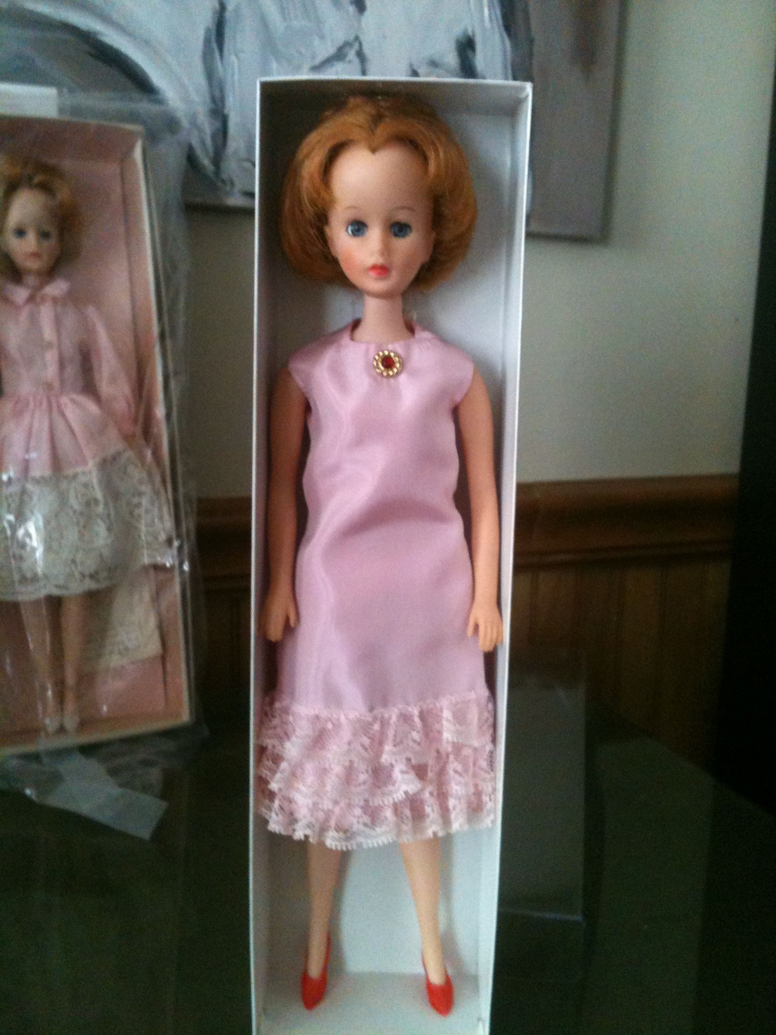 1964 Madame Alexander Brenda Starr in Pink Cocktail Dress/Afternoon Dress. I believe there is a self belt, a purse, and shoes. All possibly a darker pink. I gave her the red shoes, she came wearing a pair of white Barbie spikes! Thanks FXToys in Florida!  Collection of JP Patrick